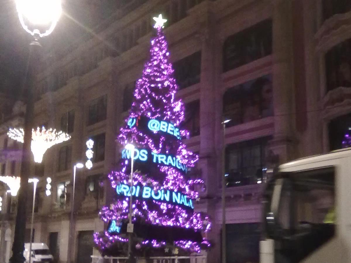 Multilingual merry x-mas tree near Placa Catalunia